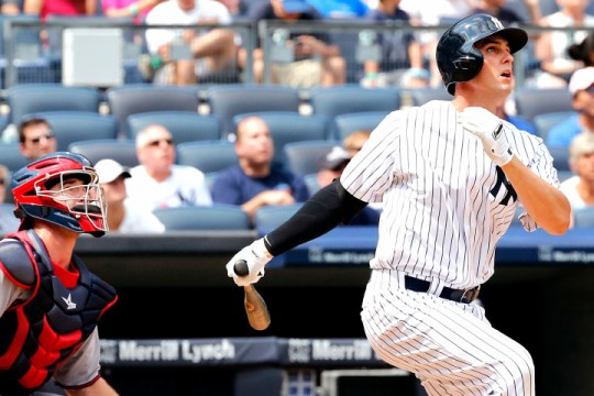 Bronx, New York 8/19/15 New York Yankees first baseman Greg Bird (31) watches his first major league home run go into the stands in the 4th inning in a baseball game at Yankee Stadium on August 19, 2015 (Paul J. Bereswill)