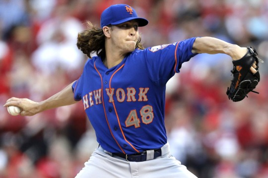New York Mets starting pitcher Jacob deGrom throws during the first inning of a baseball game against the St. Louis Cardinals Monday, June 16, 2014, in St. Louis. (AP Photo/Jeff Roberson)