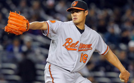 Apr 14, 2013; Bronx, NY, USA; Baltimore Orioles starting pitcher Wei-Yin Chen (16) throws a pitch against the New York Yankees during the first inning of an MLB game at Yankee Stadium. Mandatory Credit: Brad Penner-USA TODAY Sports